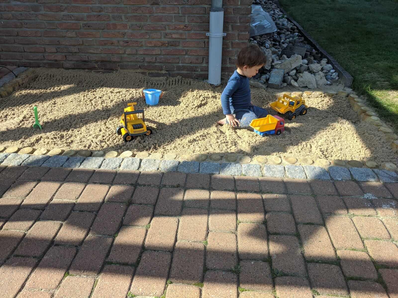 ebenerdigen Sandkasten bauen - Header Grafik