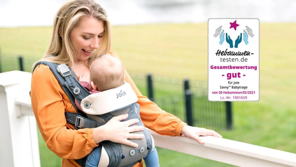Babytrage Joie Savvy Marina – Tragebild Mutter mit Tragling
